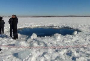 A circular hole in the ice of Chebarkul Lake where a meteorite reportedly struck the lake near Chelyabinsk on Friday.
