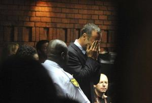 Athlete Oscar Pistorius weeps in court in Pretoria on Friday.