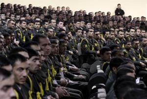 Afghan military officers listen to President Hamid Karzai's speech in Kabul, Afghanistan, Saturday.
