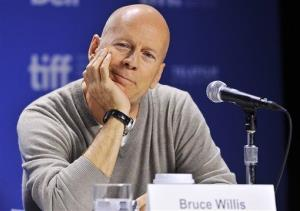 Actor Bruce Willis smiles during the press conference for his new movie Looper during the 2012 Toronto International Film Festival in Toronto on Thursday, Sept. 6, 2012.