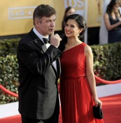 Alec Baldwin, left, and Hilaria Thomas arrive at the 19th Annual Screen Actors Guild Awards at the Shrine Auditorium in Los Angeles on Sunday, Jan. 27, 2013.