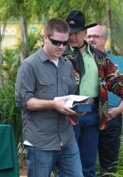 Brian Barrows, receives his award for most python caught by an unlicensed hunter, six, Saturday, Feb. 16, 2013 at Zoo Miami.