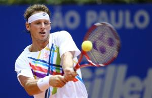 Argentina's David Nalbandian returns the ball to Spain's Rafael Nadal  during the Brazil Open ATP tournament final  match in Sao Paulo, Brazil, Sunday, Feb. 17, 2013.