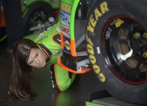 Danica Patrick checks out her car during a practice session for the NASCAR Daytona 500 Sprint Cup Series auto race at Daytona International Speedway, Saturday, Feb. 16, 2013, in Daytona Beach, Fla.