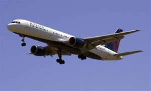 A Delta Airlines plane flies into Portland International Airport in Portland, Ore., Monday, July 20, 2009.