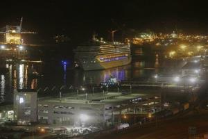 The cruise ship Carnival Triumph is towed up the Mobile River in Mobile, Ala., Thursday, Feb. 14, 2013. The ship with more than 4,200 passengers and crew members has been idled for nearly a week in the Gulf of Mexico following an engine room fire.