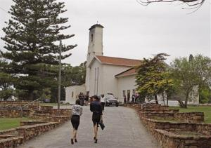 People arrive for the funeral of Reeva Steenkamp in Port Elizabeth, South Africa today.