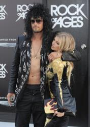 Josh Duhamel, left, and Fergie arrive at the Rock of Ages premiere at Grauman's Chinese Theatre on Friday June 8, 2012 in Los Angeles.