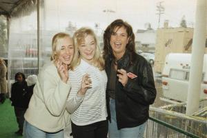 In this Jan. 26, 1997 file photo, Mindy McCready, left, LeAnn Rimes, and Terri Clark joke around after a rehearsal for the American Music Awards at the Shrine Auditorium in Los Angeles.