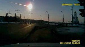 In this frame grab made from dashboard camera video, a meteor streaks through the sky over Chelyabinsk.