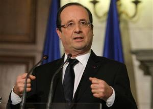 French President Francois Hollande gestures speaks during a news conference Tuesday, Feb. 19, 2013.