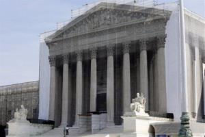 This Sept, 27, 2012 file photo shows the covered Supreme Court building in Washington.