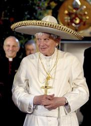 In this file picture made available on March 26, 2012, by the Vatican newspaper Osservatore Romano, Pope Benedict XVI wears a Mexican sombrero hat in Leon, Mexico, Sunday, March 25, 2012.