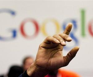 In this Oct. 17, 2012, file photo, a man raises his hand at Google's offices.