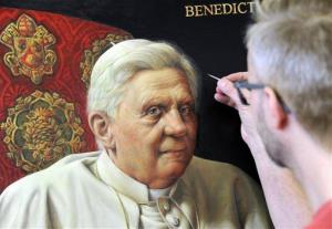 Artist Michael Triegel, known as 'Pope painter,' works on his second portrait of Pope Benedict XVI in his studio in Leipzig, Germany, Tuesday, Feb. 19, 2013.