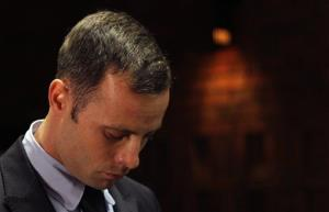 Olympic athlete Oscar Pistorius stands inside court in Pretoria, South Africa, on Tuesday.