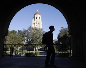 In this Feb. 15, 2012 file photo, a Stanford University student walks in front of Hoover Tower on the Stanford University campus in Palo Alto, Calif.