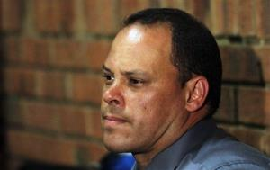 Investigating officer Hilton Botha sits inside the court witness box during the Oscar Pistorius bail hearing at the magistrate court in Pretoria, South Africa, Wednesday, Feb. 20, 2013.