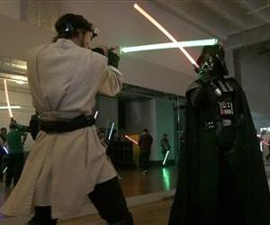Golden Gate Knights instructor Alain Block, left, and Gary Ripper, dressed as Darth Vader, demonstrate light saber moves during class in San Francisco, Feb. 10, 2013.