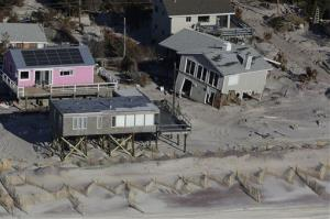 This Friday, Jan. 18, 2013 aerial file photo shows oceanfront homes on New York's Fire Island, damaged when Superstorm Sandy struck on Oct. 29, 2012.