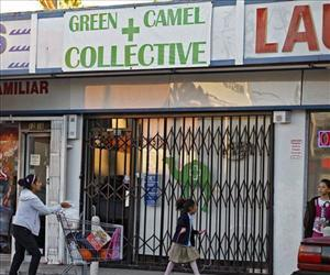 This file photo shows a family walking past a closed medical marijuana dispensary in Los Angeles.