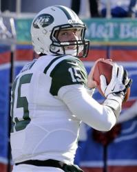 In a Dec. 30, 2012, file photo, New York Jets quarterback Tim Tebow warms up before a game.
