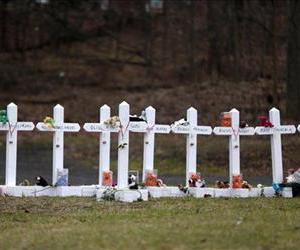 Crosses bearing the names of the Newtown shooting victims are displayed in the Sandy Hook village of Newtown, Conn., Saturday, Dec. 22, 2012.