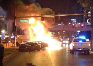 Smoke and flames billow from a burning vehicle following a shooting and multi-car accident on the Las Vegas Strip in Las Vegas early Thursday, Feb. 21, 2013.