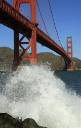 A wave breaks under the Golden Gate Bridge in San Francisco.