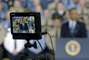 President Barack Obama is seen on a camera video monitor as he outlined his plan on gun violence, Monday, Feb. 4, 2013, in Minneapolis.