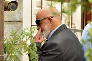 Barry Steenkamp, the father of Reeva Steenkamp, leaves his home to attend her funeral Feb. 19.