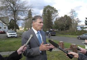 Gov. Jay Inslee talks to the media on Tuesday, Feb. 19, 2013, in Olympia, Wash.