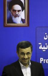 Iran's President Mahmoud Ahmadinejad smiles to journalists as he arrives to the press conference in Cairo, Egypt, Thursday Feb. 7, 2013.