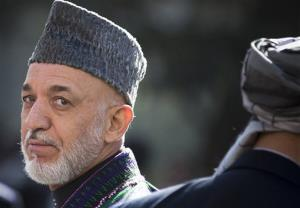 In this Friday, Oct 26, 2012 file photo, Afghan President Hamid Karzai turns after reviewing the guard of honor in Kabul, Afghanistan.