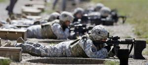 In this Sept. 18, 2012 file photo, female soldiers from 1st Brigade Combat Team, 101st Airborne Division train on a firing range while testing new body armor in Fort Campbell, Ky.