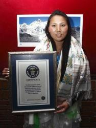 Nepalese woman mountaineer Chhurim who has been recognized by Guinness World Records for climbing Mount Everest twice in the same climbing season poses with the certificate issued to her in Katmandu.