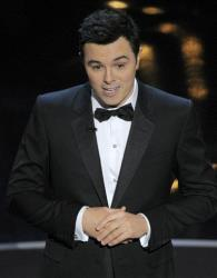 Host Seth MacFarlane speaks onstage during the Oscars at the Dolby Theatre on Sunday Feb. 24, 2013, in Los Angeles.