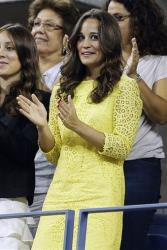 Pippa Middleton watches the quarterfinals match between Roger Federer, of Switzerland, and Tomas Berdych, of Czech Republic, at the US Open tennis tournament, Sept. 5, 2012, in New York.