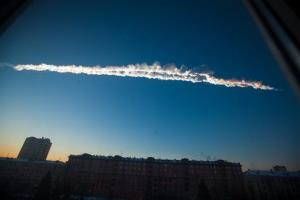 In this photo provided by Chelyabinsk.ru, a meteorite contrail is seen over Chelyabinsk on Friday, Feb. 15, 2013.