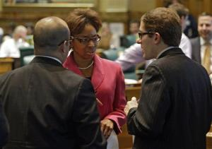 Rep. Rhonda Fields talks with Rep. Joseph Salazar and House Speaker Mark Ferrandino about her bill on limiting the size of ammunition  magazines at the Capitol in Denver on Friday, Feb. 15, 2013.