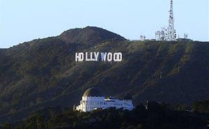 This 2011 file photo shows the famed Hollywood sign and the Griffith Park Observatory in Los Angeles.