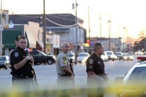 Police secure the scene near N. Branciforte Avenue and Doyle Street in Santa Cruz, Calif.