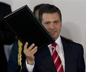 Mexico President Enrique Pena Nieto holds up an education reform proposal, taking on Elba Esther Gordillo, an iron-fisted union leader considered the country's most powerful woman.