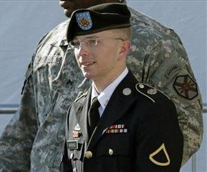 Army Pfc. Bradley Manning, right, is escorted out of a courthouse in Fort Meade, Md., Monday, June 25, 2012, after a pretrial hearing.