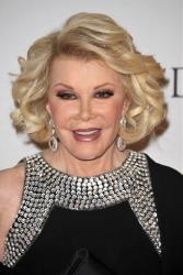 TV personality Joan Rivers arrives at the Clive Davis Pre-GRAMMY Gala on Saturday, Feb. 9, 2013 in Beverly Hills, Calif.