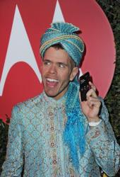 In this photograph released by Motorola via AP Images on March 26. 2012, Perez Hilton celebrates his 34th birthday at his Mad Hatter's Ball, Saturday, March 24, 2012 at Siren Studios in Los Angeles.