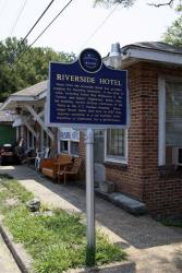 In this Aug. 3, 2011 photograph, a Mississippi Blues Trail marker rests outside the Riverside Hotel, providing tourists a brief history of the building and its lore in Clarksdale, Miss.