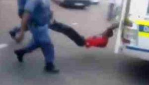 A frame grab from the video. The officers soon dropped the man's legs to the ground as the van sped up.