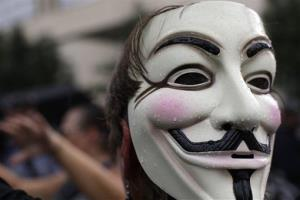 An Occupy demonstrator wears a Guy Fawkes mask during protests in Charlotte, N.C., last year.