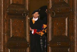 Vatican Swiss guards close the main door of the papal residence in Castel Gandolfo, south of Rome, Thursday, Feb. 28, 2013.